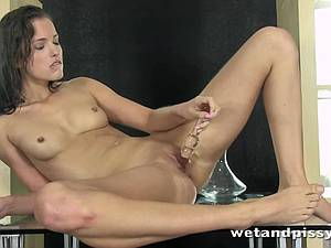 Sexy Silvia Luca rubs her pussy so good she pees