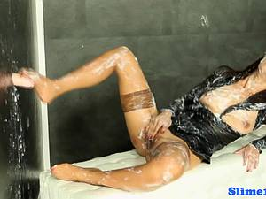 Asian at the gloryhole covered in a lot of cum